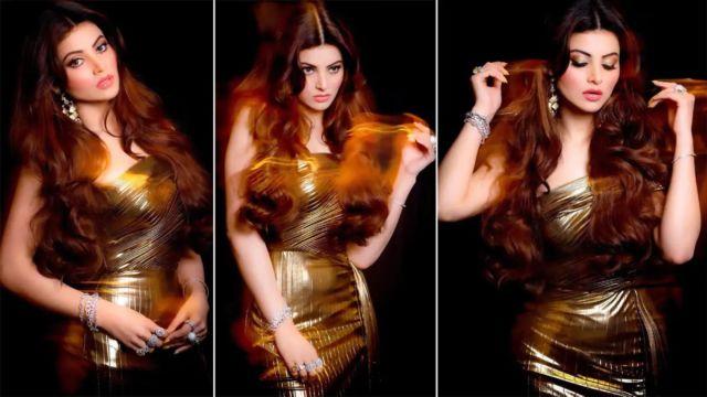 Urvashi Rautela Shines In A Metallic Gold Dress
