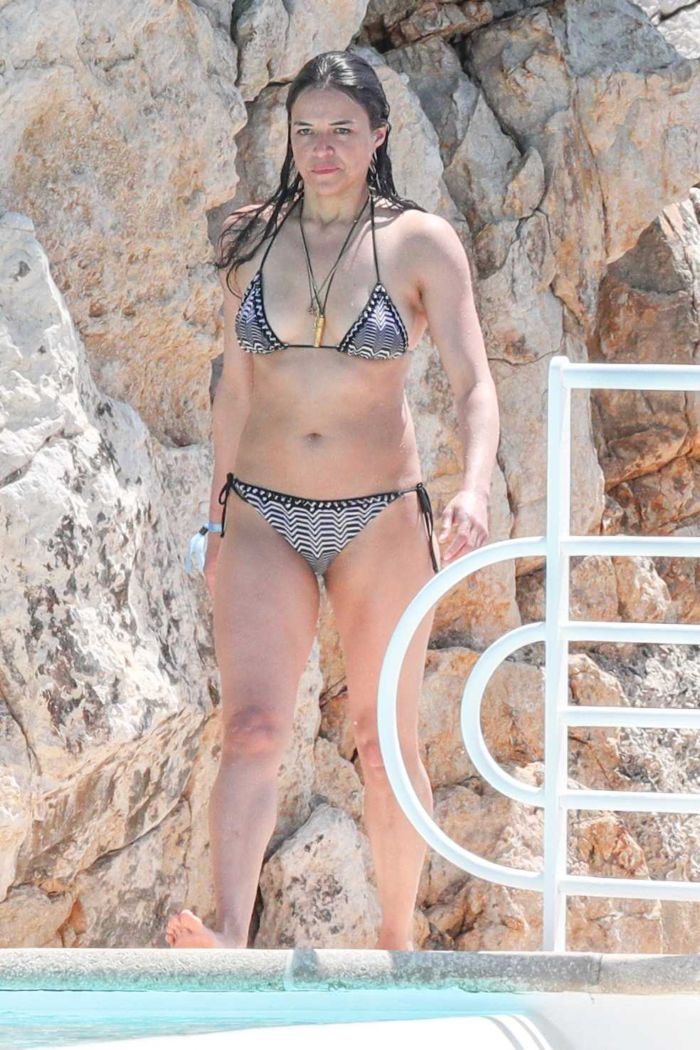 Michelle Rodriguez Diving At A Pool In Antibes